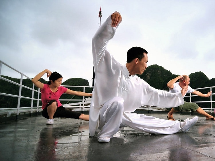 things to do in halong bay - practice tai chi on deck