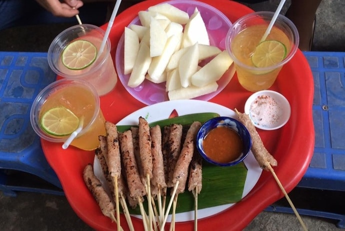grilled fermented pork roll - nem nuong co phuong