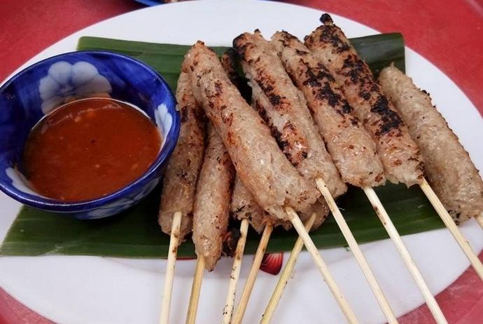 grilled fermented pork roll - nem nuong xuan dan