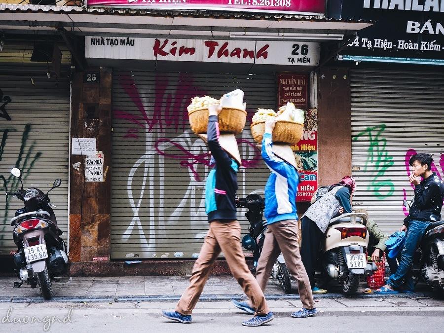 street hawkers in hanoi - street vendors